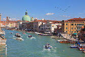 The tourists on the vaporetto on the Grand Canal — Stock Photo