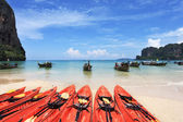 Red canoes and boats Longtail awaiting tourists — Stock Photo