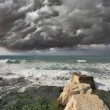 Severe storm cloud over the surf — Stock Photo