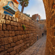 Narrow street in Old Yaffo in December - Stock Photo