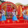 Stock Photo: Beautiful dancers on stilts represent horsemen