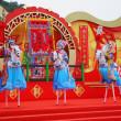 Beautiful dancers on stilts represent horsemen — Stock Photo