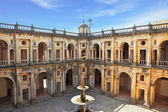 Courtyard surrounded by galleries. In the center - a fountain — Stock Photo
