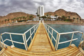 The wooden pier on a beach of Red sea — Stok fotoğraf