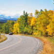 Autumn in Canada. road abruptly turns among trees — Stock Photo #25705437