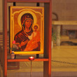 The icon of Jesus Christ, and burning candles — ストック写真