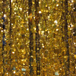 The gold tinsel — Stock Photo