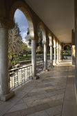 The colonnade in monastic to a garden — Stock Photo
