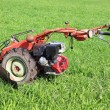 The red lawn mower — Stock Photo