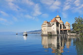 The Chato de Chillon and tourist motor ship — Photo