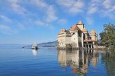 The Chato de Chillon and tourist motor ship — Stock Photo