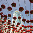 Traditional red lanterns and the modern skyscrapers — Stock Photo