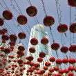 Stock Photo: Traditional red lanterns and the modern skyscrapers