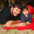 A father with son in the woods — Stock Photo #33539831