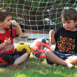 Постер, плакат: Two four year boys talk about football