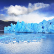 Grey glacier moves down the water — Stock Photo #39090499