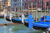 Graceful gondola approached by a palaces. — Stock Photo