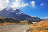 Snow-capped mountain peaks and road — Stock Photo