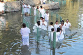 The ritual baptism of Christian pilgrims in the Jordan River — Stock Photo