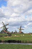 Three windmills  among deep channels — Stock Photo