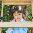 The boy climbed up a wooden sliding ladder — Stock Photo