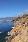 Azure ocean surf on the steep coast — Stock Photo