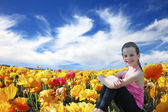 Six year old girl  smiling in a field — Stock Photo