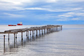 Old dilapidated pier in the Strait of Magellan — Stok fotoğraf