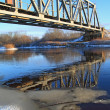 Railway bridge through small river — Stockfoto