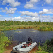 Stock Photo: Rubber boat on small river