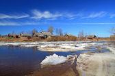 Village on coast autumn river — Stock Photo
