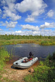 Rubber boat on small river — Stock Photo