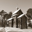 Wooden chapel in pine wood, sepia — Stock Photo #13566185