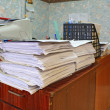 Royalty-Free Stock Photo: Heap of the papers on table in office