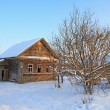 Stock Photo: Old rural house amongst snow