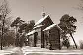 Wooden chapel in pine wood, sepia — Stock Photo