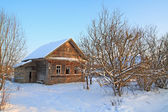 Old rural house amongst snow — Stock Photo
