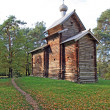 Foto Stock: Wooden chapel in autumn wood