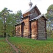 Foto de Stock  : Wooden chapel in autumn wood