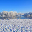 White ice on winter river — Stock Photo