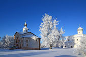 Christian orthodox church on snow field — Stock Photo