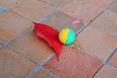 Ball near red sheet on tiled floor — Stock Photo