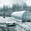Plastic hothouse in winter garden — Stock Photo