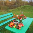 Autumn still life on green table — Stock Photo #13894172