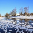 Winter village on coast river  — Foto de Stock
