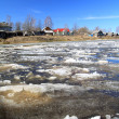 Driving of ice on river to will to villages — Stock Photo