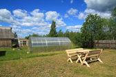 Wooden furniture in rural garden — Stock Photo