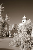 Orthodox christian church amongst snow tree, sepia — Stock Photo