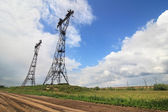 Iron supports for the high-voltage wires. — Stock Photo