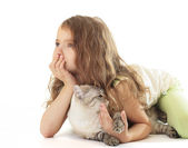Little girl hugged her cat and dreaming. — Stock Photo